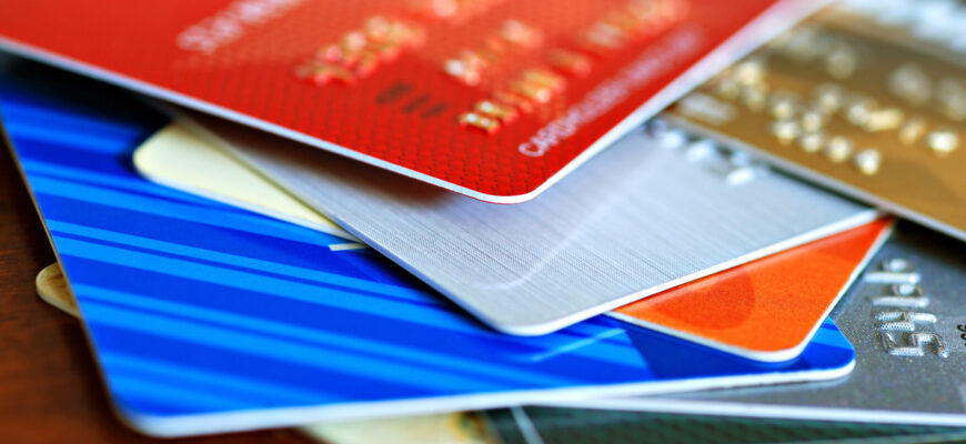 a close up of a colorful stack of credit cards